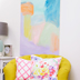 A soft peaceful abstract coupled with a yellow chair